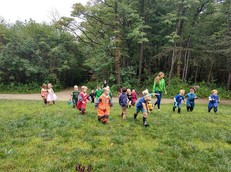 students running through grass