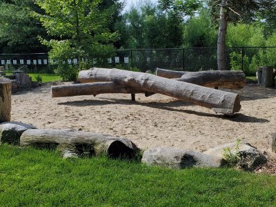 Natural playscape balance beam made from logs